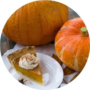Pumpkins and Pumpkin Pie on a Table