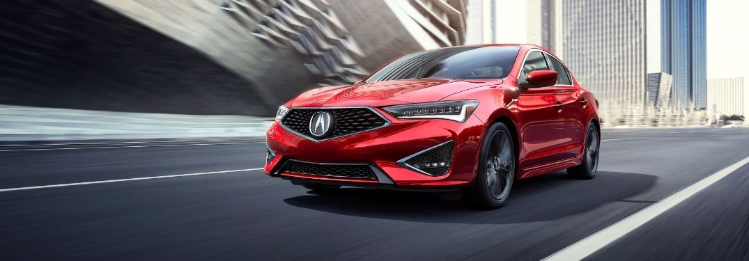 Red 2021 Acura ILX on a City Freeway