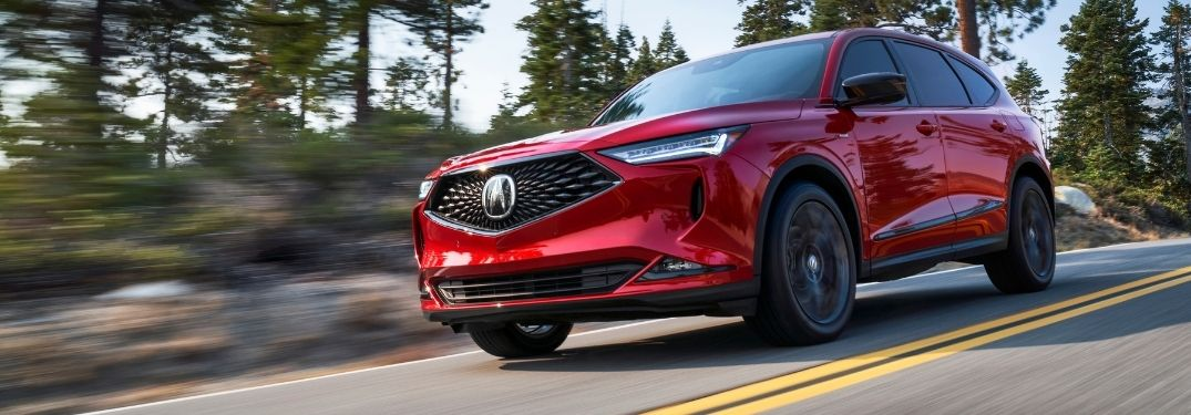 Red 2022 Acura MDX on a Country Highway