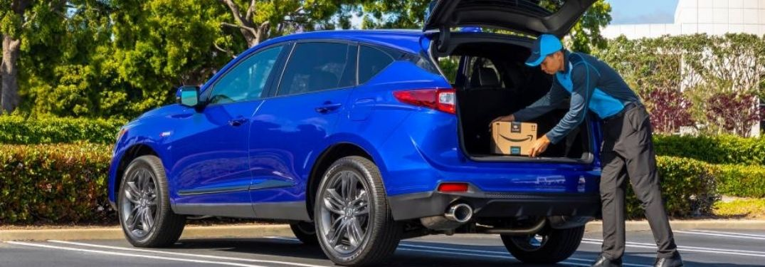 Man Loading Cargo in Back of 2021 Acura RDX