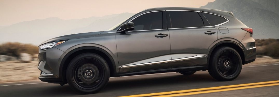 Gray 2022 Acura MDX Side Exterior on a Country Road