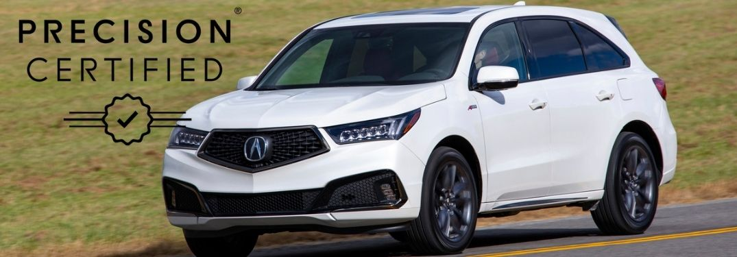 White 2019 Acura MDX on a Country Road with Black Acura Precision Certified Logo