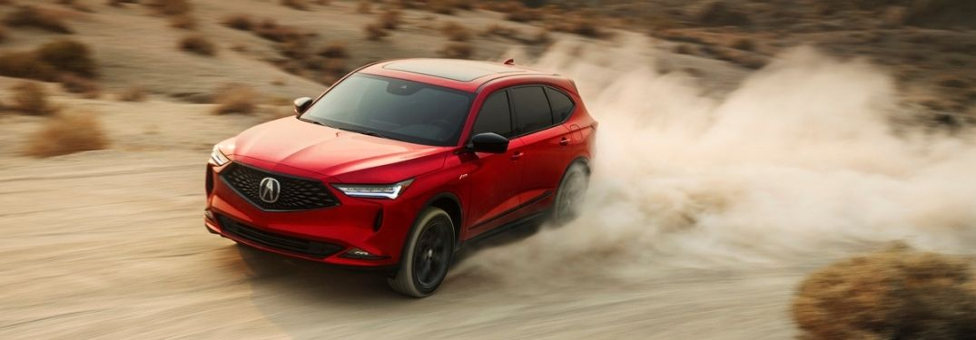 Red 2022 Acura RDX on a Dirt Trail