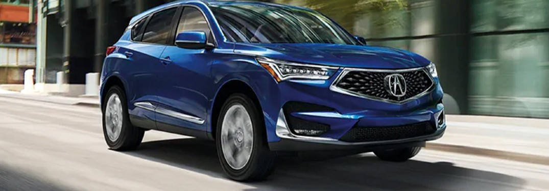 A 2021 Acura RDX driving in the city