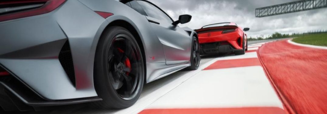 red and grey 2022 Acura NSX racing side by side