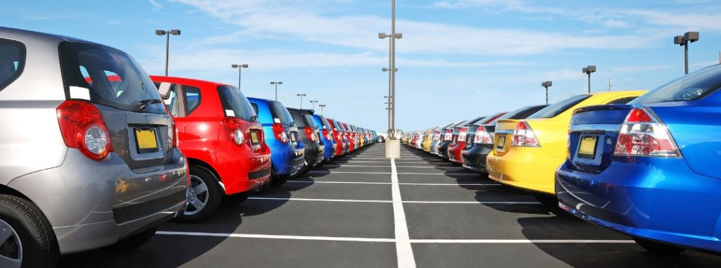 Lineup of colorful cars on dealership lot