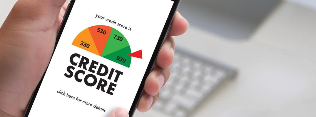 Hand holding phone with credit score scale on screen