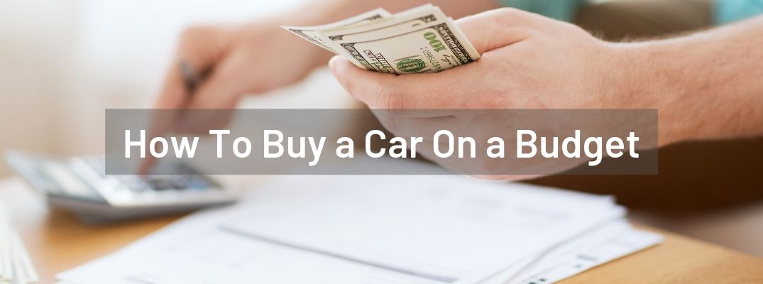 """Individual counting money and using a calculator with """"How To Buy a Car On a Budget"""" white text"""