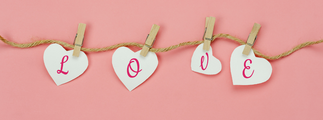 Love letters held with clothespins on pink background