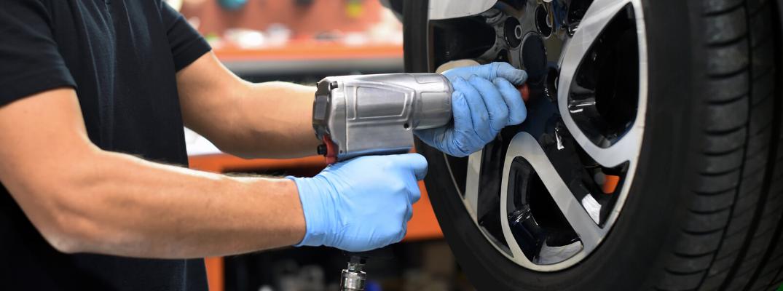 Mechanic repairing a vehicle's tire