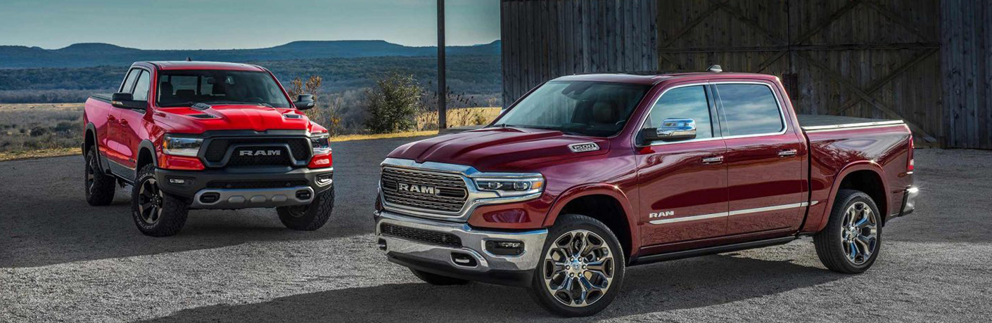 maroon ram pickup in front of bright red ram pickup