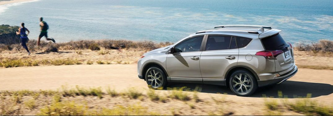 2018 Toyota RAV4 full view driving by some water