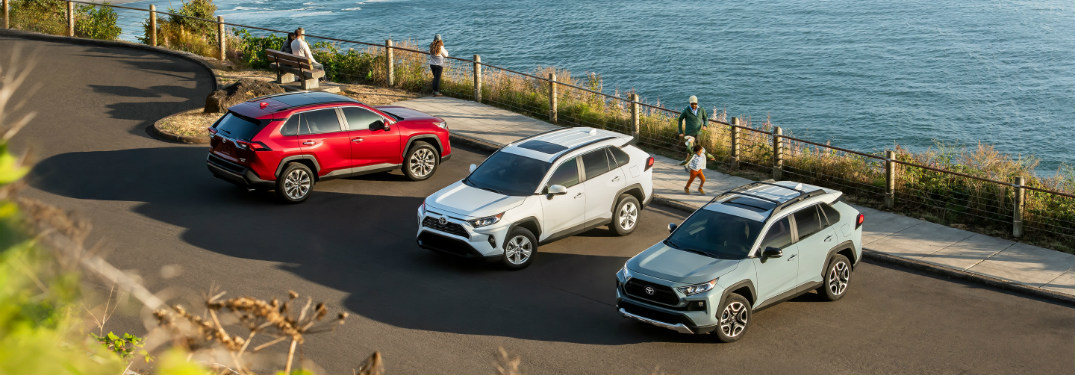 row of toyota rav4 models at the beach