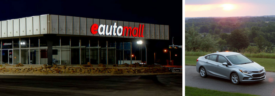 e Auto Mall Dealership Sign at Night and Silver 2017 Chevy Cruze on a Country Road at Dusk