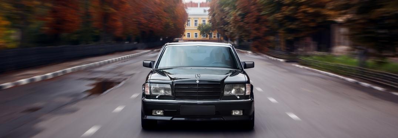 Black classic Mercedes-Benz driving at camera