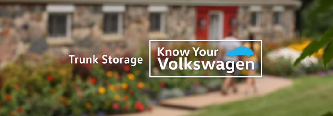 """tet that says """"Trunk Storage Know Your Volkswagen"""" over blurred image of a farm house"""