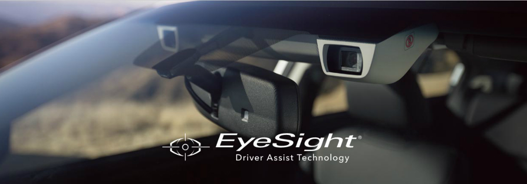 """view of rearview mirror and cameras through windshield with overlaid text that says """"EyeSight Driver Assist Technology"""""""