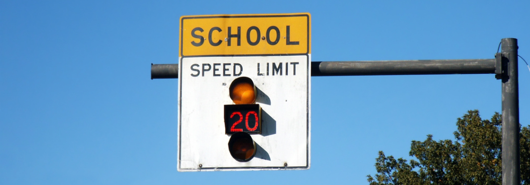 school zone speed limit sign with 20 mph speed limit