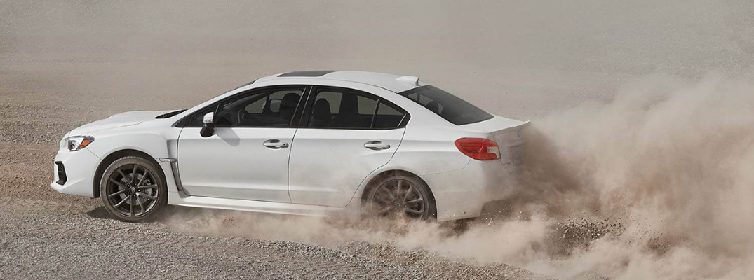 Side View of White 2019 Subaru WRX with Clouds of Dirt at the Rear