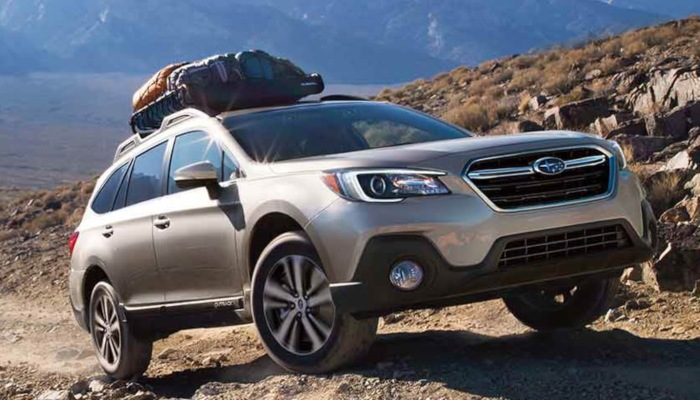 2019 Subaru Outback driving up a rocky slope