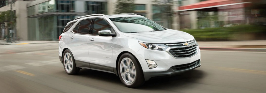 2019 Chevy Equinox driving down a city street