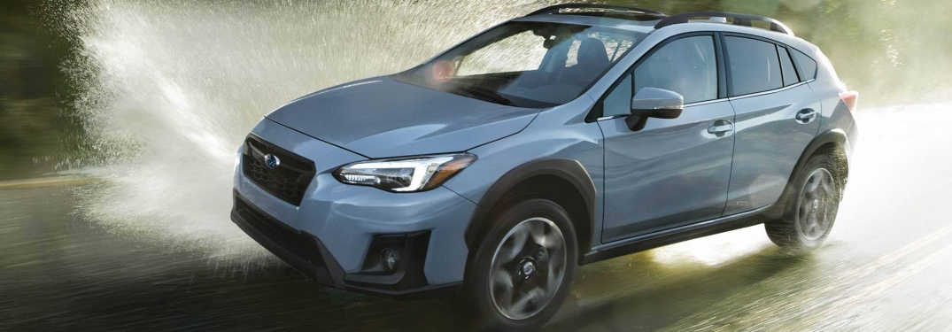 2019 Subaru Crosstrek blue side view driving through water
