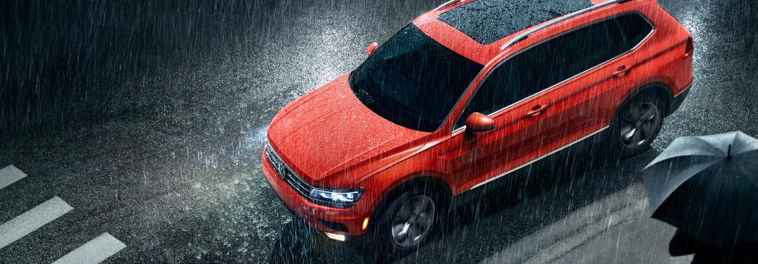 2019 Volkswagen Tiguan parked on a city road in the rain