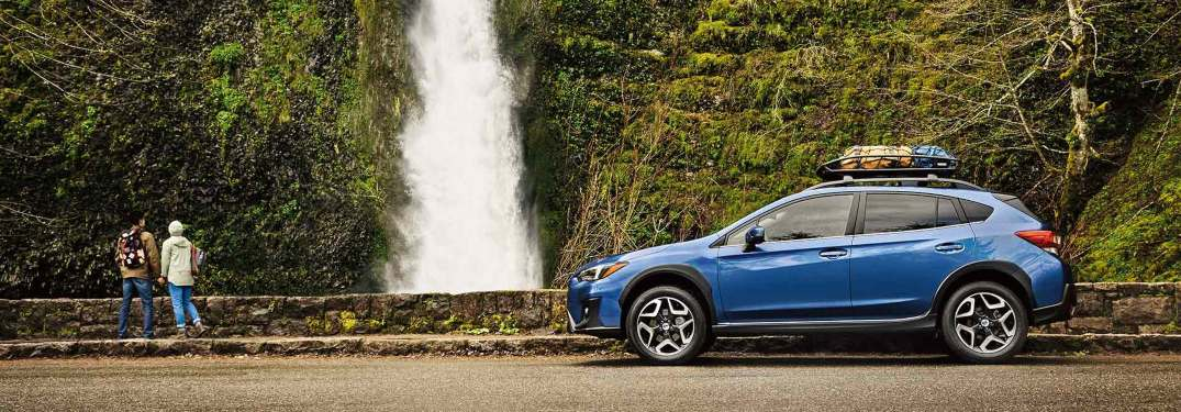 2019 Subaru Crosstrek parked in front of a waterfall