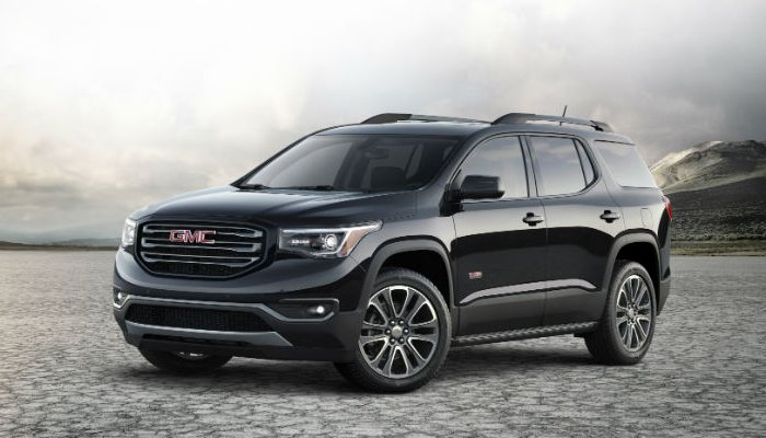2019 GMC Acadia parked on a stone field