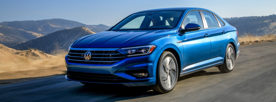 2019 Volkswagen Jetta exterior shot blue paint on road