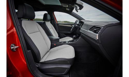 2019 Volkswagen Jetta interior shot from passenger seat through open door red
