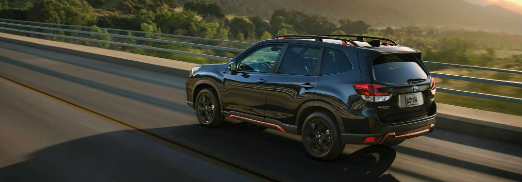 2020 Subaru Forester exterior back fascia and driver side going fast on blurred road