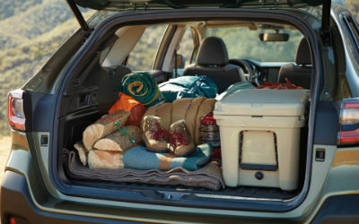 2020 Subaru Outback exterior looking into cargo space packed with camping gear