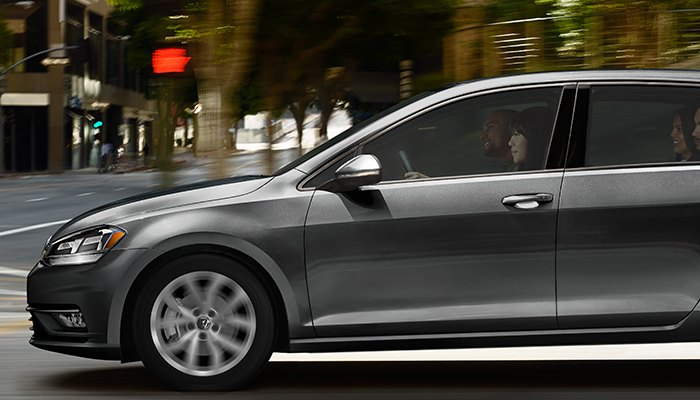 2019 Volkswagen Golf SE driving down a city street