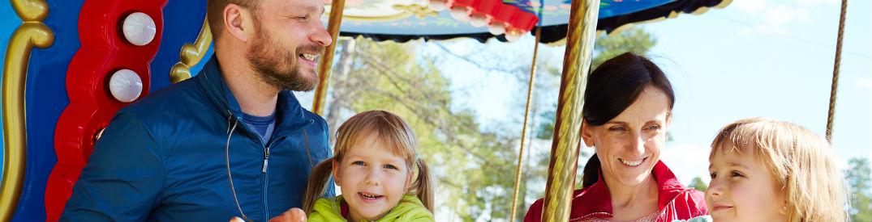 Smiling family on Ferris Wheel