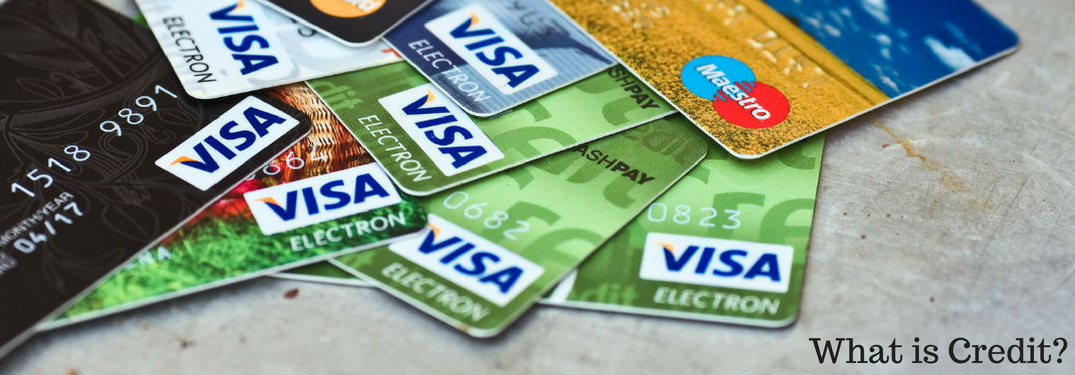 What is Credit?, text on an image of credit cards strewn atop a table