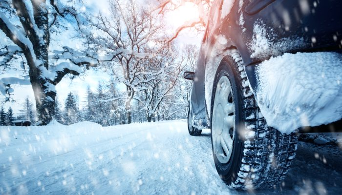 Close-up on a vehicle's tire in the snow