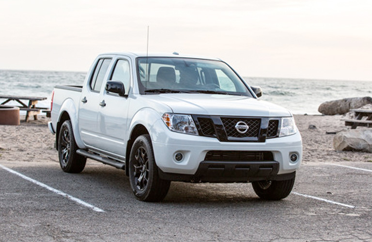 White 2019 Nissan Frontier in parking space