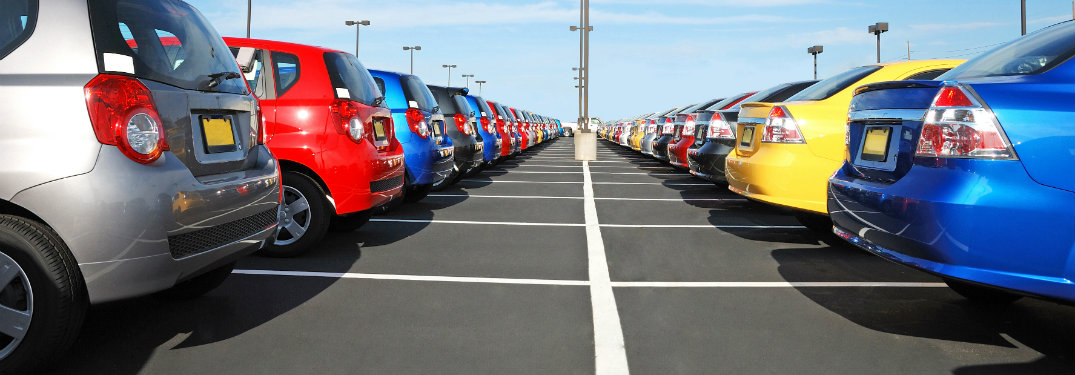 rear of colorful cars in parking lot