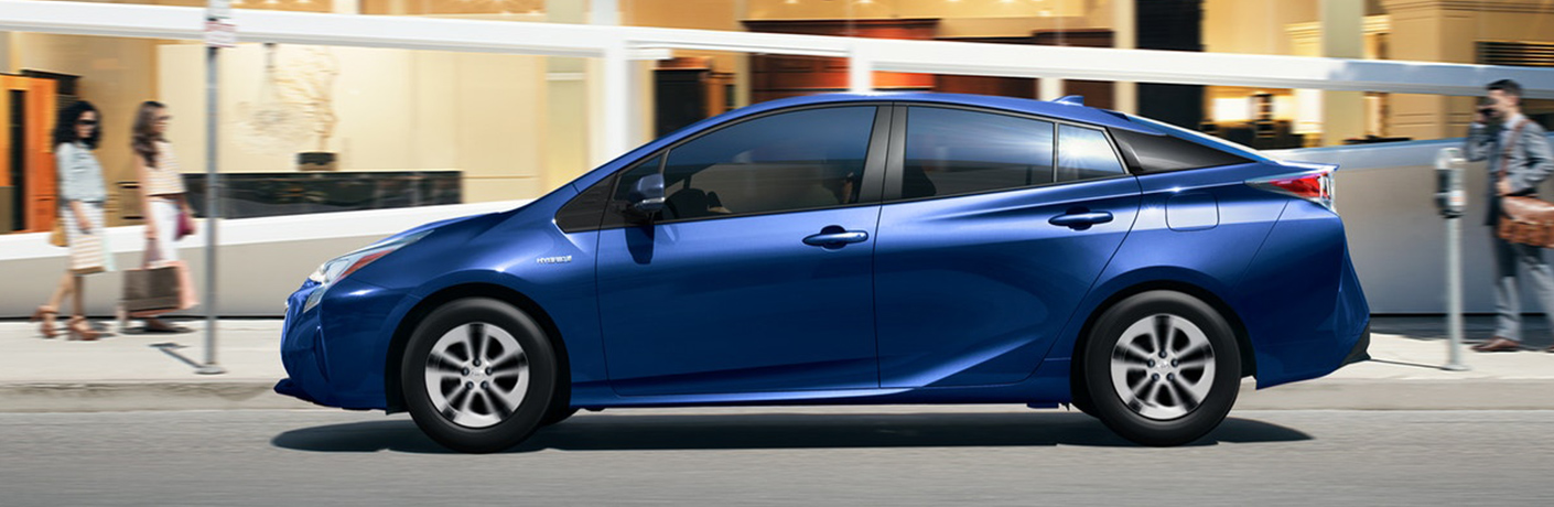 Blue 2018 Toyota Prius parked in front of a store