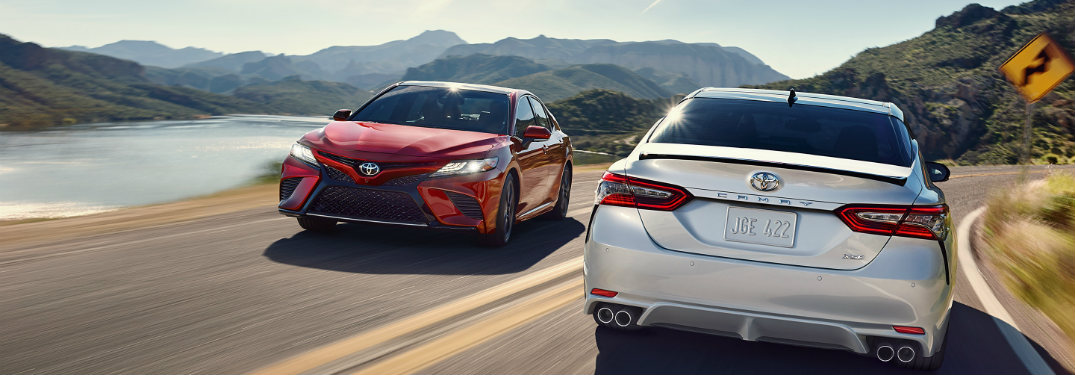 Two 2018 Toyota Camrys driving past each other