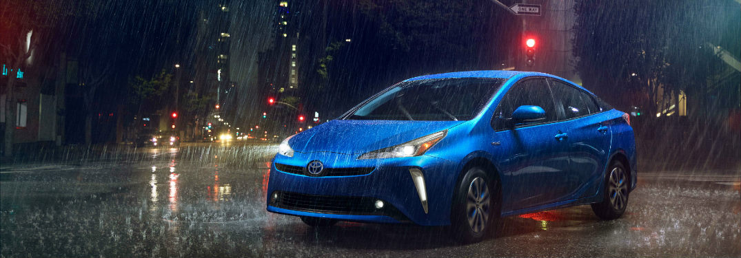 2019 Toyota Prius parked on a rainy city road