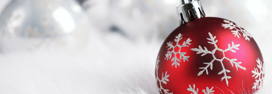 Red Christmas ornament over a white background