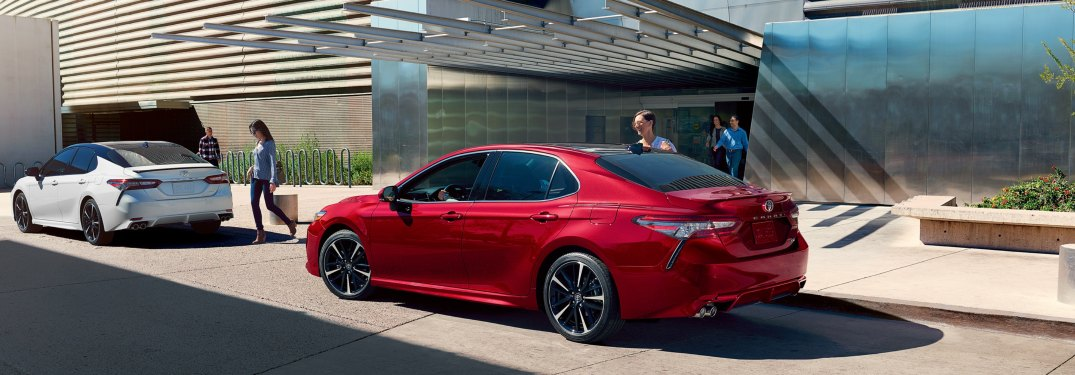 A person getting into a parked 2019 Toyota Camry