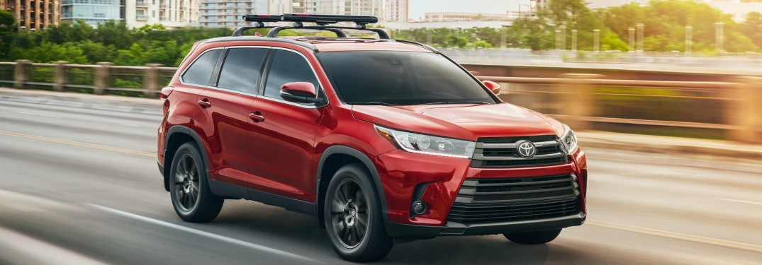 2019 Toyota Highlander driving down a city road