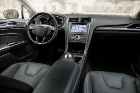 front interior of 2019 ford fusion including steering wheel and center infotainment system