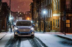 Ford Escape driving on a snow-covered road
