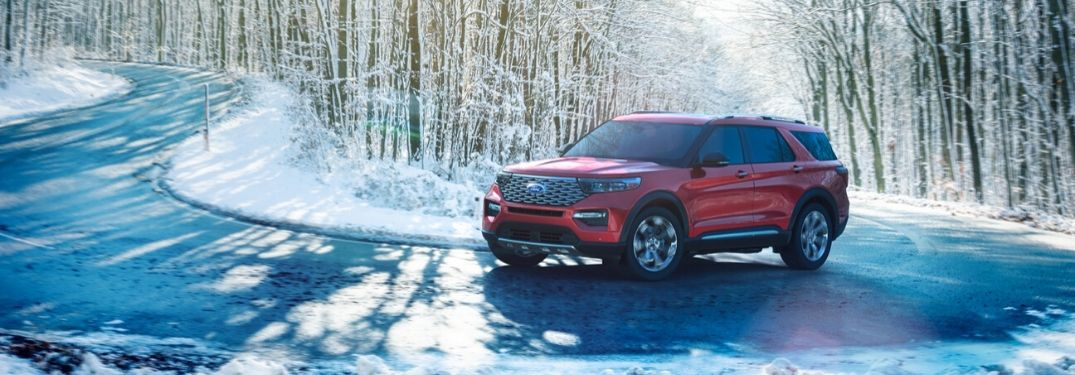 2020 Ford Explorer driving down snowy road from exterior front drivers side