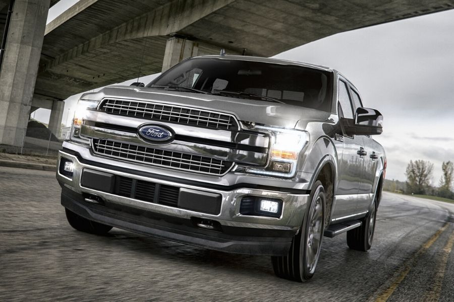 2020 Ford F-150 LARIAT driving toward camera from exterior front drivers side