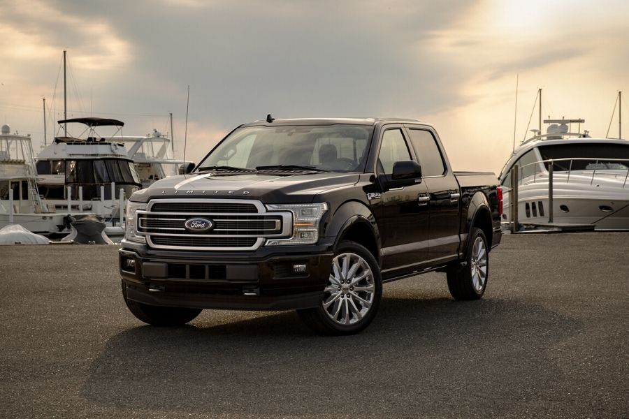 2020 Ford F-150 Limited in front of boats from exterior front drivers side